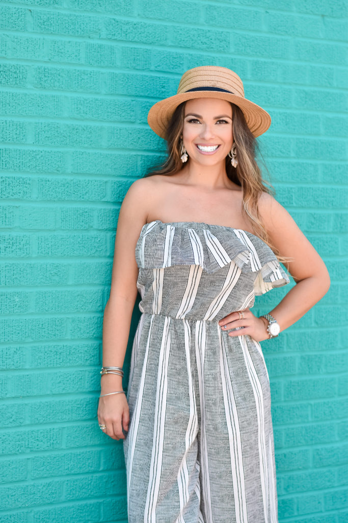 the perfect summer jump suit with straw hat